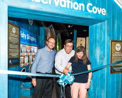 Courgeous fundraiser Suzannah Foulds cuts the ribbon as Max Leviston of Brighton Sea Life Centre with Andy Bool of the Sea Life Trust declare Conservation Cove open. photo ©Julia Claxton- graphics fifty50