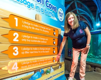 Suzannah Foulds sends a message in a bottle pledge as Conservation Cove opens at Brighton Sea Life Centre photo ©Julia Claxton- graphics fifty50