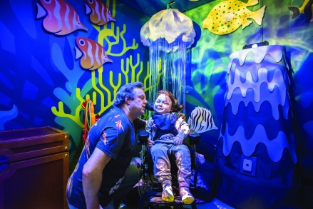 Jacob Pepperrell and his father William Thornton in the Sea Life Brighton sensory room at the Royal Alexander Children's Hospital, Brighton, East Sussex, UK photo ©Julia Claxton